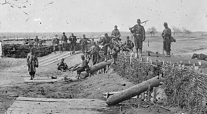 Soldiers in abandoned Confederate works near Centreville, Virginia, one of three photographs taken by George Barnard in March 1862. (Library of Congress)