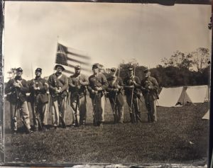 Tintype of some of the men of the 53rd PVI, Company C with our colors (2016). Courtesy of www.mototintype.com. Included are (L to R): Sgt. Marc Benedict, Corporal Matthew Steger, Private Joseph Marks, Private John Rentschler, Private Jeff Marks, Private Doug Raab, Private Steve Dillon, and Sgt. Mark Fasnacht.